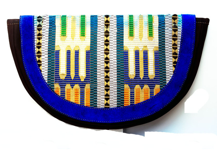KAFFA TEXTILE CLUTCH 220.00 A colorful and intricate hand-woven textile infused into chocolate brown pull-up leather clutch bag, suede border and magnetic snap closure. Cloth lined with an inside zipper pocket   *Handmade in Ethiopia